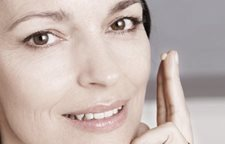 Women using two fingers to tab care into cheek