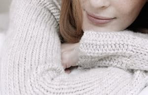 Woman wearing a cotton pullover.