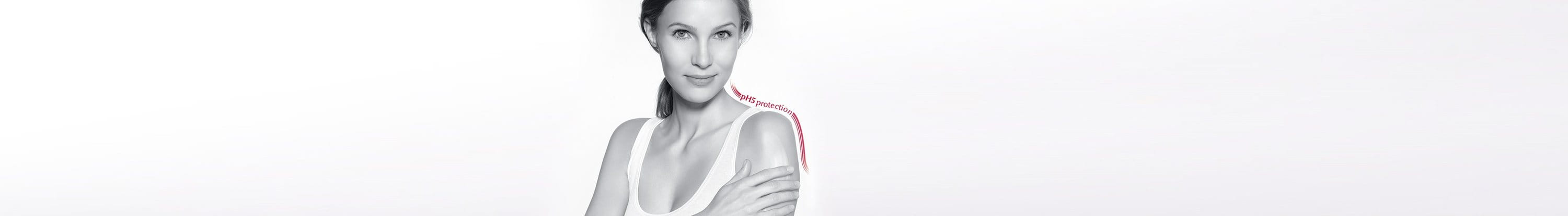 Woman applying lotion on her shoulder and packshot of  Eucerin pH5 Skin-Protection Lotion