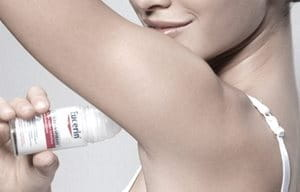 Woman uses Eucerin 48 h Anti-Transpirant Roll-On